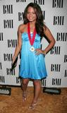 Christina Milian shows legs in blue dress at 56th Annual BMI Pop Awards in Beverly Hills